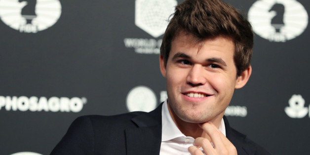 Magnus Carlsen smiles after defeating Sergey Karjakin at the 2016 World Chess Championship match in New York